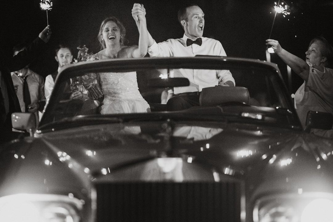 couple leaving in wedding car