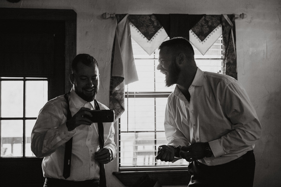 groom laughing with groomsman