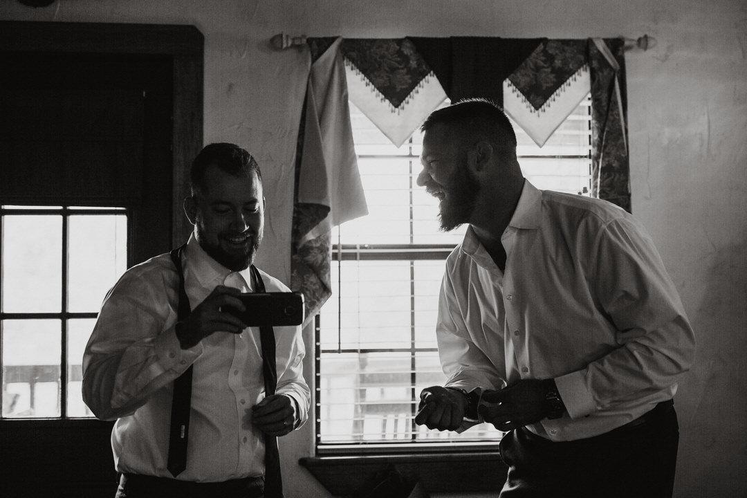 groom laughing with groomsman