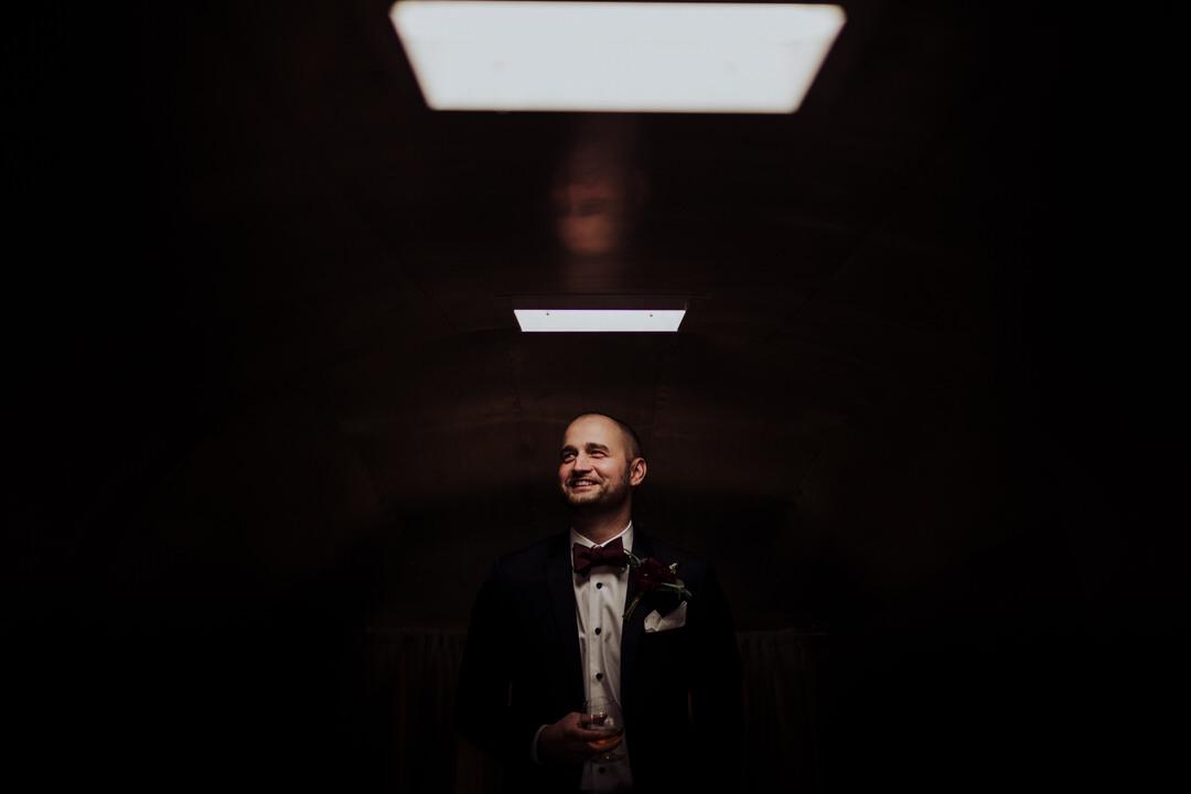 moody portrait of groom