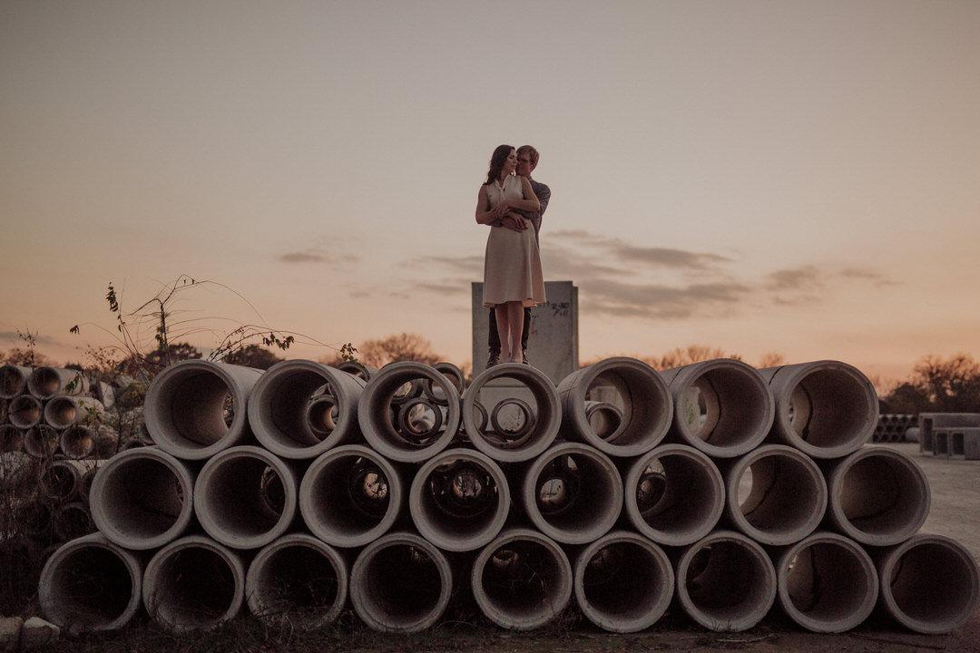romantic sunset photo of engaged couple