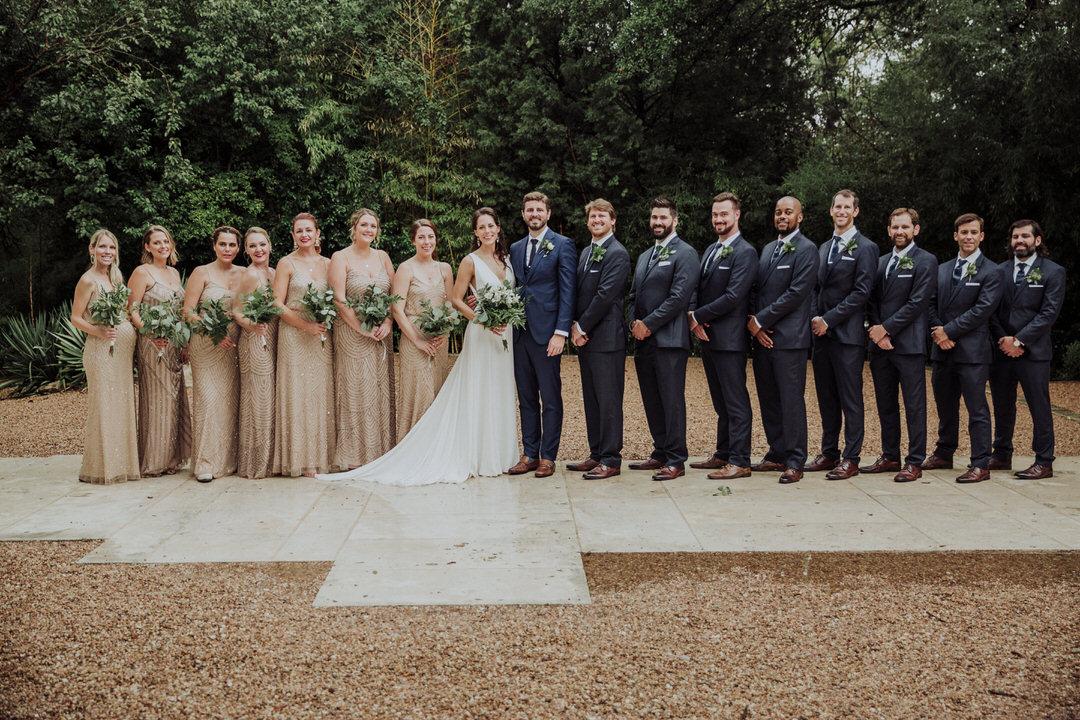 bridal party photo of bridesmaids and groomsmen