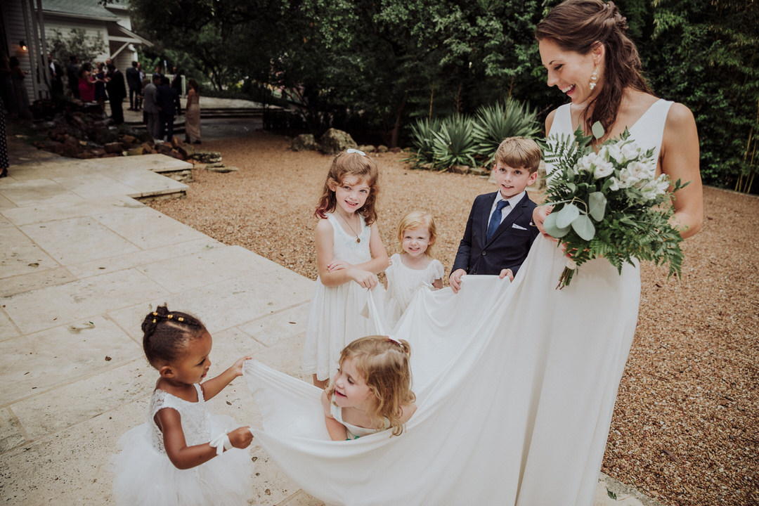 flower girl with bride at her wedding