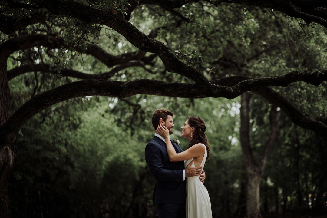 photo of couple in front of trees