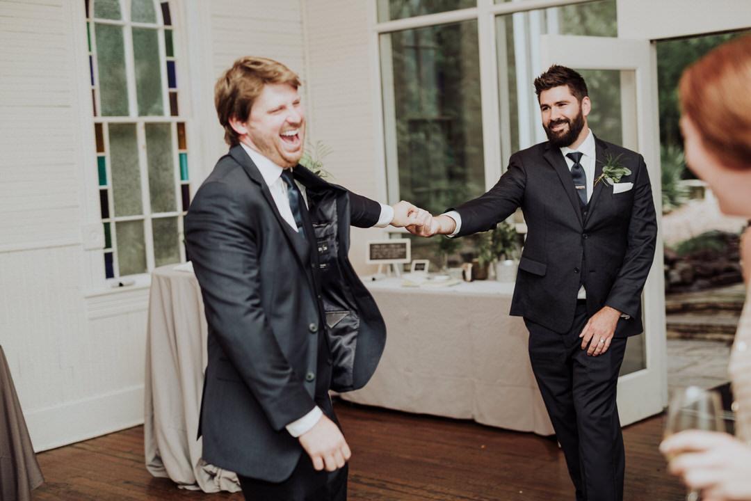 groomsmen dancing before reception