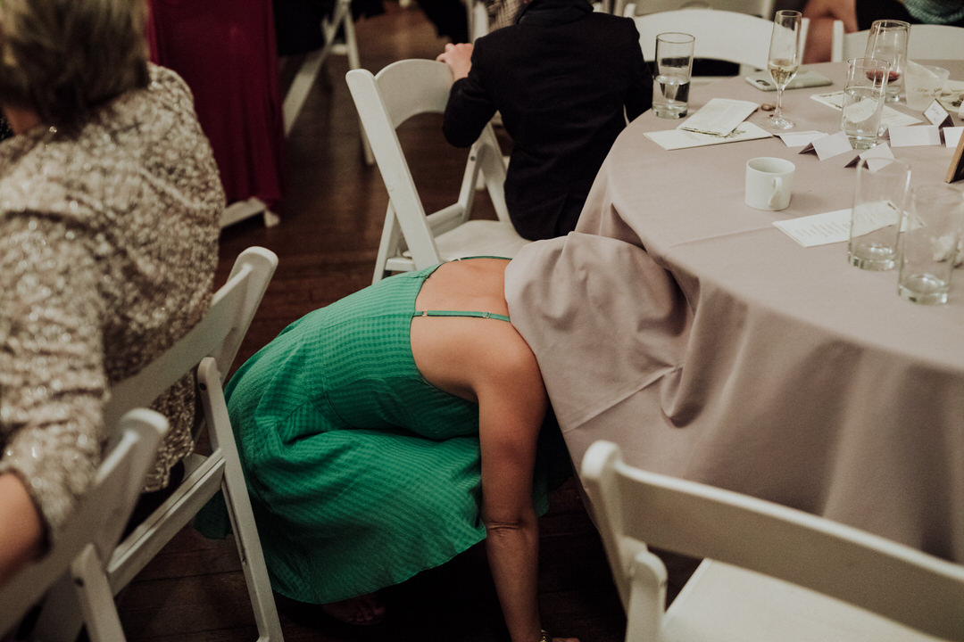funny photo of guest under table