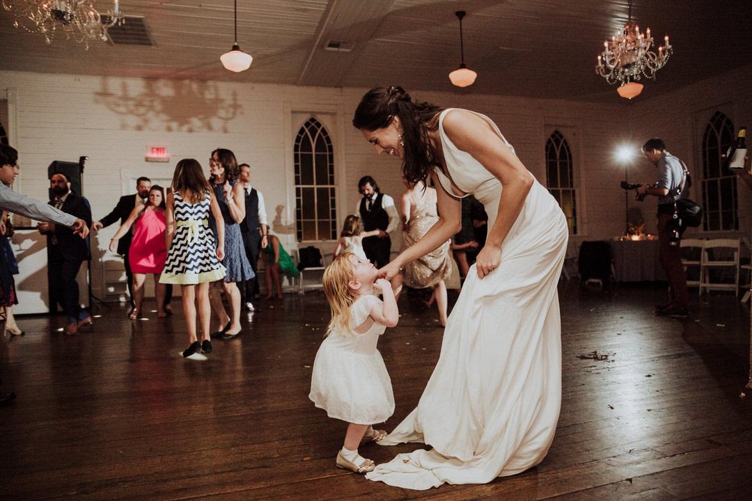 bride with flower girl on wedding dance floor
