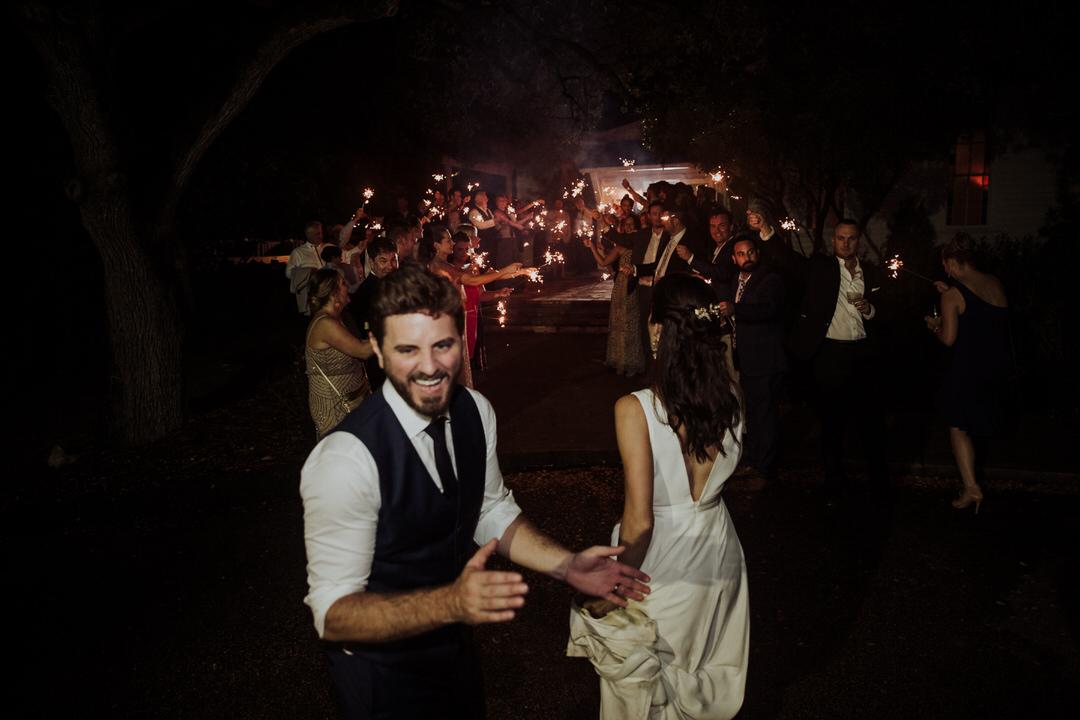 groom excited after sparkler exit
